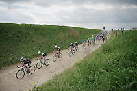 each of the major players have their teammates controlling the peloton so not to let the breakaway stay away until the end<br /> <br /> Paris - Roubaux 2014