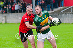 Knocnagoshel's Shane O'Connell wins the ball ahead of Tarbert's Kevin Enright in theirJunior county championship clash in Tarbert on Sunday last.