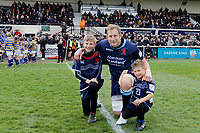 Mark Bright of London Scottish with mascots during the Greene King IPA Championship match between London Scottish Football Club and Richmond at Richmond Athletic Ground, Richmond, United Kingdom on 27 April 2019. Photo by Carlton Myrie.