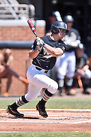 Vanderbilt Commodores left fielder Walker Grisanti (17) swings at a pitch during a game agains against the Tennessee Volunteers at Lindsey Nelson Stadium on April 24, 2016 in Knoxville, Tennessee. The Volunteers defeated the Commodores 5-3. (Tony Farlow/Four Seam Images)