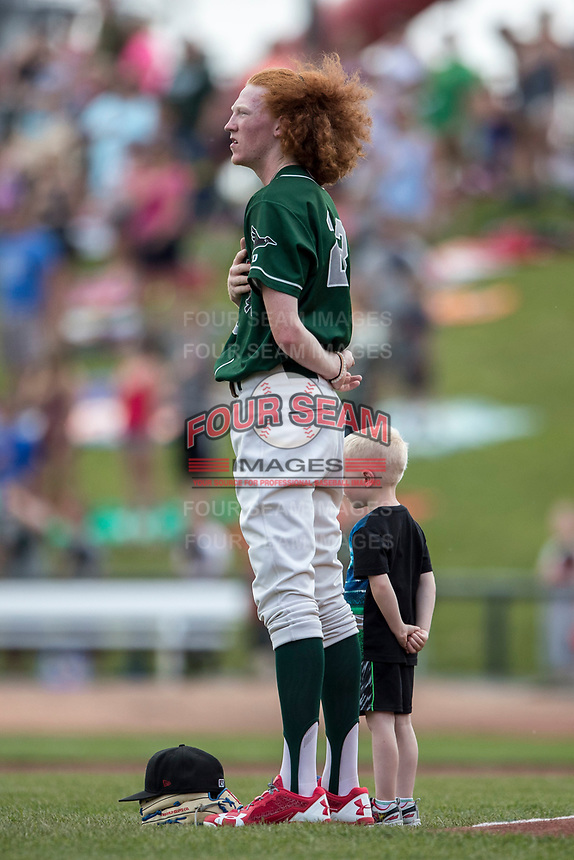 Great Lakes Loons pitcher Dustin May (23) stands for the national anthem before the Midwest League baseball game against the Bowling Green Hot Rods on June 4, 2017 at Dow Diamond in Midland, Michigan. Great Lakes defeated Bowling Green 11-0. (Andrew Woolley/Four Seam Images)