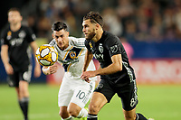 CARSON, CA - SEPTEMBER 15: Graham Zusi #8 of Sporting Kansas City moves to the ball during a game between Sporting Kansas City and Los Angeles Galaxy at Dignity Health Sports Complex on September 15, 2019 in Carson, California.