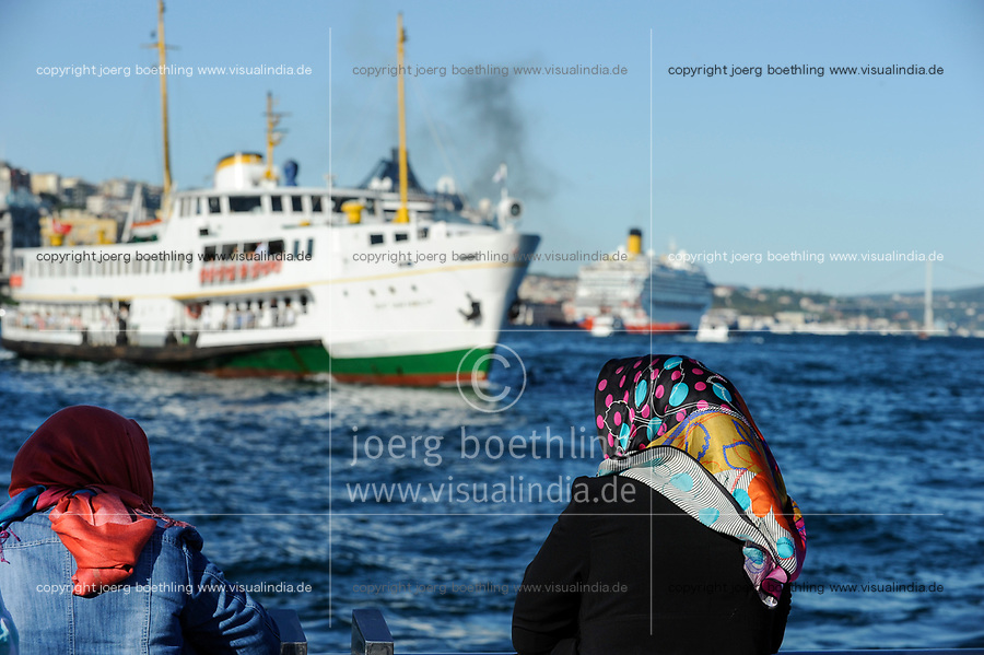 TURKEY Istanbul, ferry boat at Bosporus, women with headscarf / TUERKEI Istanbul, Faehre am Bosporus