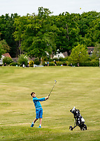 A young golfer plays his shot. Covid-19 Golf phased exit at Hever Castle Golf club, Edenbridge, England on 17 May 2020. Photo by Liam McAvoy.<br /> <br /> Hever Castle Golf club opened its golf course on May 13, 2020 in Edenbridge, Kent.<br /> Golf courses reopen in England under government guidelines after Prime Minister Boris Johnson announced the general contours of a phased exit from the current lockdown.