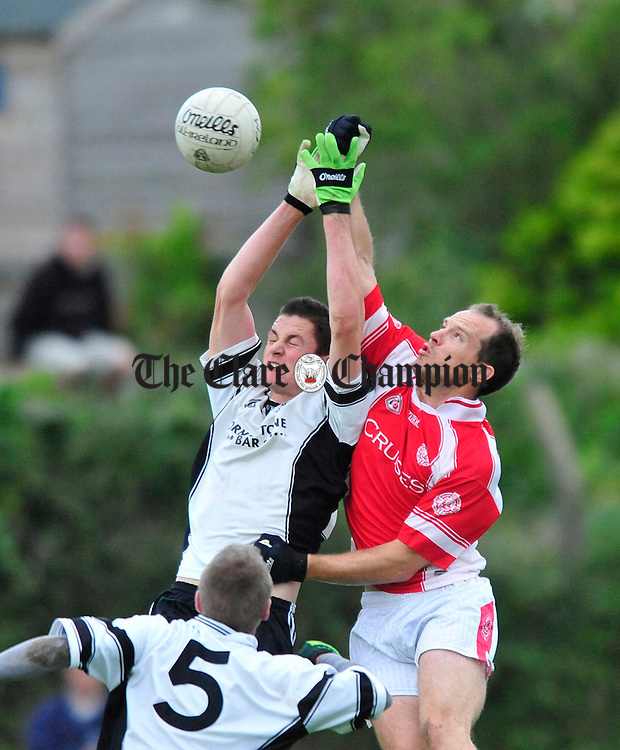 Francis O' Loughlin of Ennistymon battles for posession with Eire Og's Brian Frawley. Photograph by Declan Monaghan.