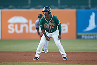 Isael Soto (15) of the Greensboro Grasshoppers takes his lead off of second base against the Augusta GreenJackets at First National Bank Field on April 10, 2018 in Greensboro, North Carolina.  The GreenJackets defeated the Grasshoppers 5-0.  (Brian Westerholt/Four Seam Images)