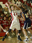 SOUTHBURY, CT, 01/02/08- 010208BZ04- Pomperaug's Katie Cizynski (44) is fouled by Notre Dame's Jesika Holmes (32) during their game at Pomperaug High School in Southbury Wednesday night.<br /> Jamison C. Bazinet Republican-American