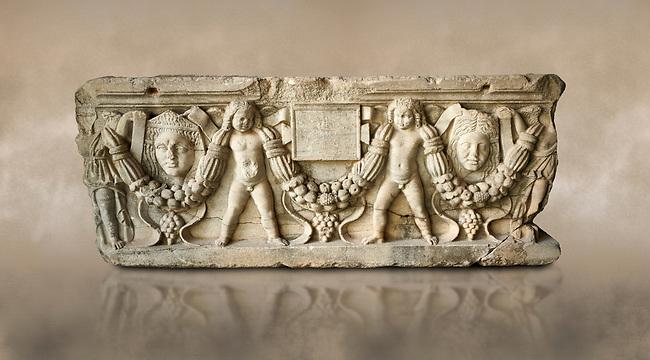 Roman relief sculpted garland sarcophagus with cherubs, 3rd century AD. Adana Archaeology Museum, Turkey. Against a warm art background