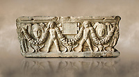 Roman relief sculpted garland sarcophagus with cherubs, 3rd century AD. Adana Archaeology Museum, Turkey. Against a warm art background
