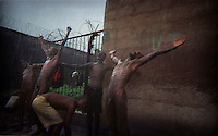 Inmates washing in the rain during the rainy season in Pademba Central Prison. The prison has no running water and there's a general shortage of drinking water. To have bath, prisoners have to pay 1000 leones (US $ 0.25). .