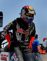 Apr 8, 2006; Las Vegas, NV, USA; NHRA Top Fuel driver Melanie Troxel climbs out of the Skull Gear/Torco Race Fuels dragster following a qualifying run for the SummitRacing.com Nationals at Las Vegas Motor Speedway in Las Vegas, NV. Mandatory Credit: Mark J. Rebilas