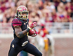 Florida State running back Dalvin Cook runs in for a touchdown in the first half of an NCAA college football game against Chattanooga in Tallahassee, Fla., Saturday, Nov. 21, 2015.  Florida State defeated Chattanooga 52-13.  (AP Photo/Mark Wallheiser)