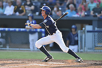 Asheville Tourists right fielder Jordan Patterson #10 swings at a pitch during a game against the Kannapolis Intimidators at McCormick Field on June 7, 2014 in Asheville, North Carolina. The Tourists defeated the Intimidators 7-5. (Tony Farlow/Four Seam Images)