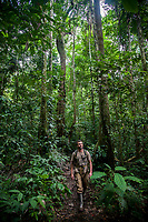 A man walks through Peruís Amazon Jungle.