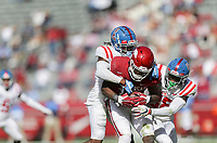 Ole Miss defenders block Arkansas wide receiver Treylon Burks (16), Saturday, October 17, 2020 during the first quarter of a football game at Donald W. Reynolds Razorback Stadium in Fayetteville. Check out nwaonline.com/201018Daily/ for today's photo gallery. <br /> (NWA Democrat-Gazette/Charlie Kaijo)
