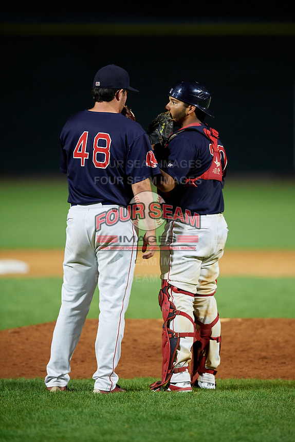 Lowell Spinners relief pitcher Kevin Biondic (48) talks with catcher Alberto Schmidt (20) during a game against the Vermont Lake Monsters on August 25, 2018 at Edward A. LeLacheur Park in Lowell, Massachusetts.  Vermont defeated Lowell 4-3.  (Mike Janes/Four Seam Images)