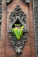 Bali, Indonesia.   Canang (Offering) in a Wall-niche adjacent to Entrance to a House.  Tenganan Village.