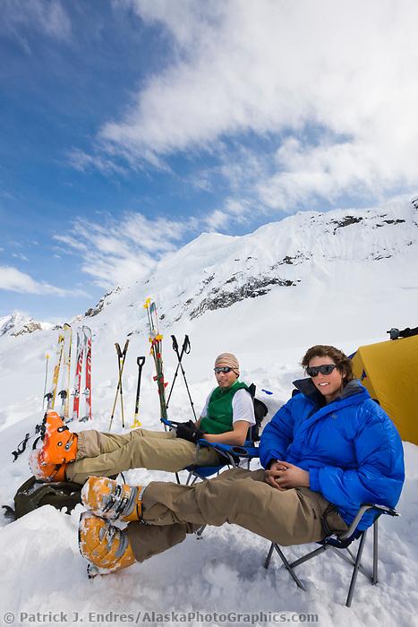 Climbers relax at base camp in the Alaska Range mountains, Interior, Alaska.