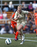 Boston College midfielder Jana Jeffrey (12) on the attack. .After two overtime periods, Boston College (gold) tied University of Miami (orange), 0-0, at Newton Campus Field, October 21, 2012.