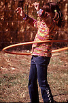YOUNG GIRL PLAYS IN HULA HOOP AT PUMPKIN FESTIVAL IN COLORADO