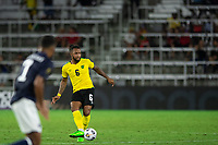 ORLANDO, FL - JULY 20: Liam Moore #6 of Jamaica passes the ball during a game between Costa Rica and Jamaica at Exploria Stadium on July 20, 2021 in Orlando, Florida.