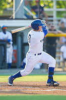 Chase Vallot (8) of the Burlington Royals follows through on his swing against the Princeton Rays at Burlington Athletic Park on July 11, 2014 in Burlington, North Carolina.  The Rays defeated the Royals 5-3.  (Brian Westerholt/Four Seam Images)
