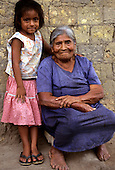 San Ignacio, Peru. Old woman and little girl.