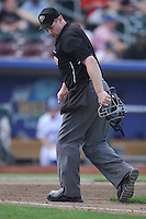 Home plate umpire Brian Hertzog checks the first base line during the game between the Las Vegas 51s and the Omaha Storm Chasers at Werner Park on August 17, 2014 in Omaha, Nebraska. The Storm Chasers  won 4-0.   (Dennis Hubbard/Four Seam Images)