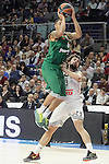 Real Madrid's Sergio Llull (r) and Panathinaikos Athens' A.J. Slaughter during Euroleague match.January 22,2015. (ALTERPHOTOS/Acero)