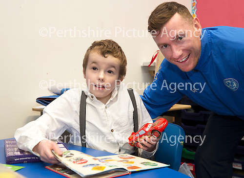 St Johnstone players visit Fairview School in Perth.....19.12.13<br /> Paddy Cregg pictured with 9 year old Taylor Stewart.<br /> Picture by Graeme Hart.<br /> Copyright Perthshire Picture Agency<br /> Tel: 01738 623350  Mobile: 07990 594431
