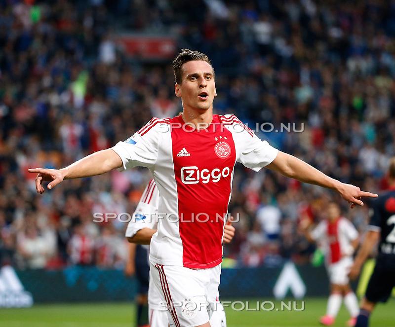 Nederland, Amsterdam, 15 augustus 2015<br /> Eredivisie<br /> Seizoen 2015-2016<br /> Ajax-Willem ll (3-0)<br /> Arek Milik van Ajax juicht nadat hij een doelpunt heeft gemaakt