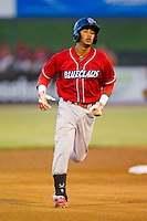 Angelo Mora (18) of the Lakewood BlueClaws rounds the bases after hitting a home run against the Kannapolis Intimidators at CMC-Northeast Stadium on August 13, 2013 in Kannapolis, North Carolina.  The Intimidators defeated the BlueClaws 12-8.  (Brian Westerholt/Four Seam Images)