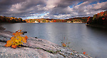 Beautiful atmospheric fall landscape panoramic nature scenery with gray dramatic cloudy sky at sunrise. Lake George, Killarney provincial park, Ontario, Canada.
