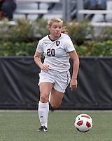 Harvard University midfielder Lauren Urke (20) brings the ball forward. In overtime, Harvard University defeated Yale University,1-0, at Soldiers Field Soccer Stadium, on September 29, 2012.