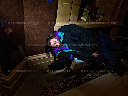 Madison, Wisconsin.USA .Feb 2011..Protestor sleeps in a hallway of the state capitol in Madison, Wisconsin, USA, on 24 February 2011. Protestors have occupied the state capitol for the past ten days protesting the governor's attempt to push through a bill that would restrict collective bargaining for most government workers