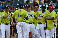 Estevan Florial of the Charleston RiverDogs is greeted by South teammates after the first round of the Home Run Derby as part of of the South Atlantic League All-Star Game festivities on Monday, June 19, 2017, at Spirit Communications Park in Columbia, South Carolina. (Tom Priddy/Four Seam Images)
