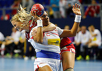Spainís Marta Elisabet Mangue (R) vies with Norwayís Ida Alstad (L) during their Women's Handball World Championship 2013 match Norway vs Spain on December 7, 2013 in Zrenjanin.   AFP PHOTO / PEDJA MILOSAVLJEVIC
