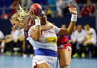 Spainís Marta Elisabet Mangue (R) vies with Norwayís Ida Alstad (L) during their Women's Handball World Championship 2013 match Norway vs Spain on December 7, 2013 in Zrenjanin.   AFP PHOTO / PEDJA MILOSAVLJEVIC