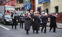 San Francisco, California, USA.  Chinatown. Green Street Mortuary Band Leads a Funeral Procession.