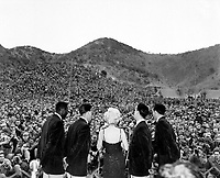 Marilyn Monroe sings several songs for an estimated 13,000 men of the First Marine Division.  Miss Monroe stopped by at the First Marine Regiment on her tour of the military units in Korea.  February 16, 1954.  Cpl. Kreplin.  (Marine Corps)<br /> NARA FILE #  127-N-A365478<br /> WAR & CONFLICT BOOK #:  1467