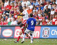 Chicago Fire defender Bakary Soumare (4) wins a header.  The Chicago Fire defeated English Premier League Team Everton FC 2-0 in a friendly match at Toyota Park in Bridgeview, IL, on July 30, 2008.