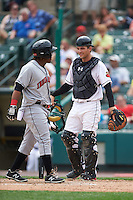 Rochester Red Wings catcher John Ryan Murphy (12) jokes with Gift Ngoepe (5) during an at bat during a game against the Indianapolis Indians on May 26, 2016 at Frontier Field in Rochester, New York.  Indianapolis defeated Rochester 5-2.  (Mike Janes/Four Seam Images)