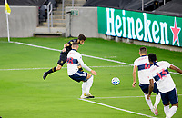 LOS ANGELES, CA - SEPTEMBER 23: Diego Rossi #9 of the LAFC takes a shot during a game between Vancouver Whitecaps and Los Angeles FC at Banc of California Stadium on September 23, 2020 in Los Angeles, California.