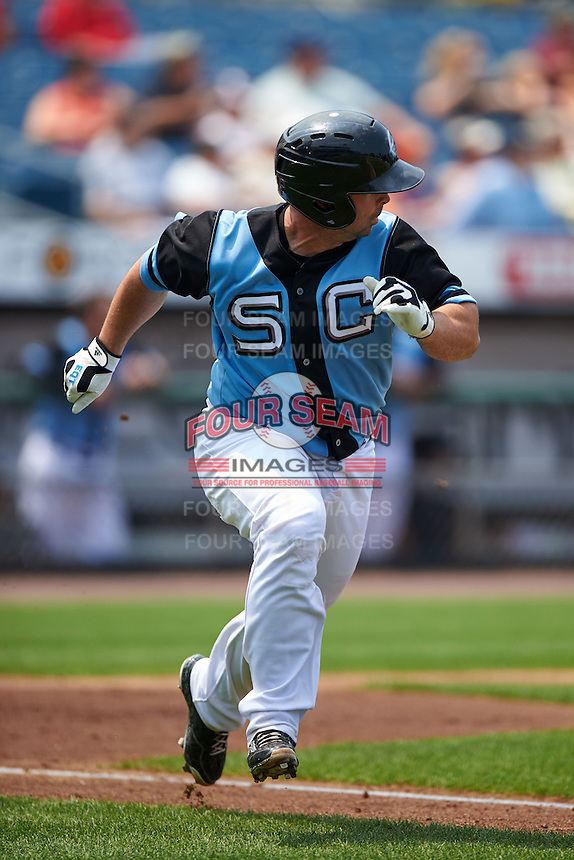 Syracuse Chiefs catcher Dan Butler (12) runs to first during a game against the Pawtucket Red Sox on July 6, 2015 at NBT Bank Stadium in Syracuse, New York.  Syracuse defeated Pawtucket 3-2.  (Mike Janes/Four Seam Images)