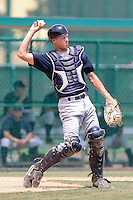 Kyle Perkins (20) Catcher for the GCL Yankees during a game on July 13th, 2010 against the GCL Braves at the Disney Wide World of Sports in Orlando, Florida. The GCL Yankees are the Gulf Coast Rookie League affiliate of the New York Yankees. Photo By Mark LoMoglio/Four Seam Images