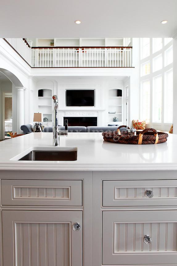 White kitchen island in open plan kitchen