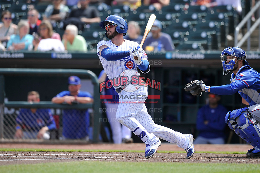 Iowa Cubs third baseman Stephen Bruno (11) swings during a game against the Round Rock Express at Principal Park on April 16, 2017 in Des  Moines, Iowa.  The Cubs won 6-3.  (Dennis Hubbard/Four Seam Images)