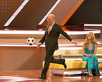 Heidi Klum watches Franz Beckenbauer kick the ball to the guests in attendance at the draw. The final draw for the 2006 FIFA World Cup took place in the Congress Centre in Leipzig, Germany on December 9 2005.