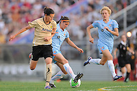 Brittany Taylor (14) of Sky Blue FC holds off Christine Sinclair (12) of FC Gold Pride. FC Gold Pride defeated Sky Blue FC 1-0 during a Women's Professional Soccer (WPS) match at Yurcak Field in Piscataway, NJ, on May 1, 2010.