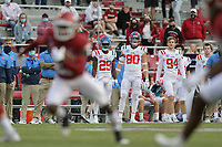 Ole Miss miss players watch, Saturday, October 17, 2020 during the fourth quarter of a football game at Donald W. Reynolds Razorback Stadium in Fayetteville. Check out nwaonline.com/201018Daily/ for today's photo gallery. <br /> (NWA Democrat-Gazette/Charlie Kaijo)